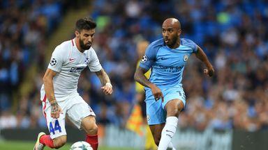 Steaua Bucharest's Gabriel Enache (left) and Manchester City's Fabian Delph in action