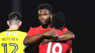 Daniel Sturridge celebrates one of his two goals against Burton Albion
