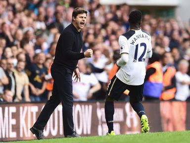 Mauricio Pochettino (L) and Victor Wanyama celebrate