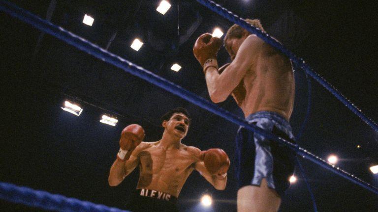 Alexis Arguello (left) backs Jim Watt into the ropes