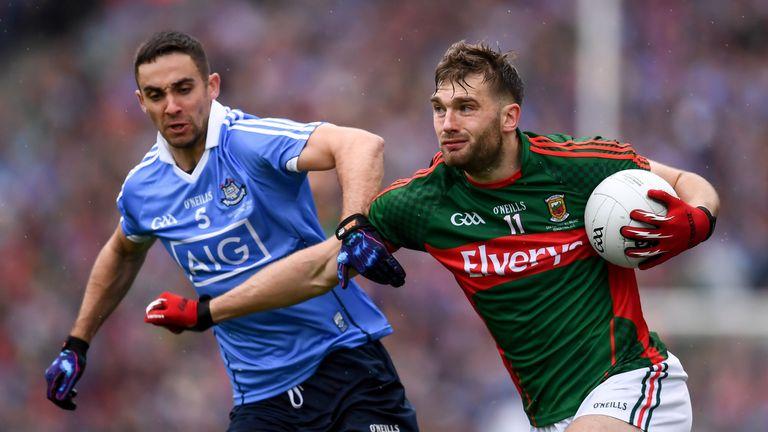 Aidan O'Shea is tackled by Dublin defender James McCarthy