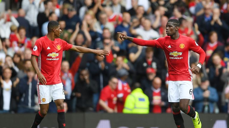 Paul Pogba celebrates with Marcus Rashford after scoring his side's fourth goal