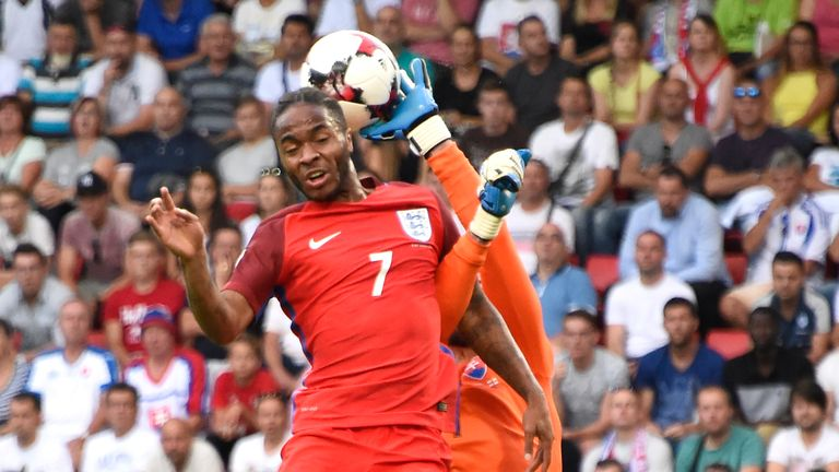 Raheem Sterling almost beat Slovakia goalkeeper Matus Kozacik to the ball early on.