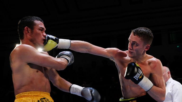 Reece Bellotti turns over a right hand against Rafael Castillo