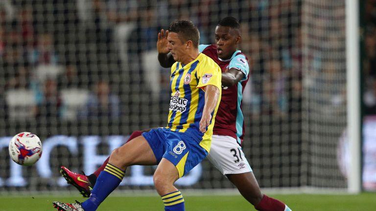 Accrington's Scott Brown is pressured by Edmilson Fernandes