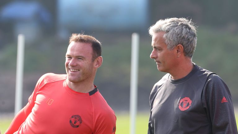 Jose Mourinho and Wayne Rooney look on during a Manchester United training session