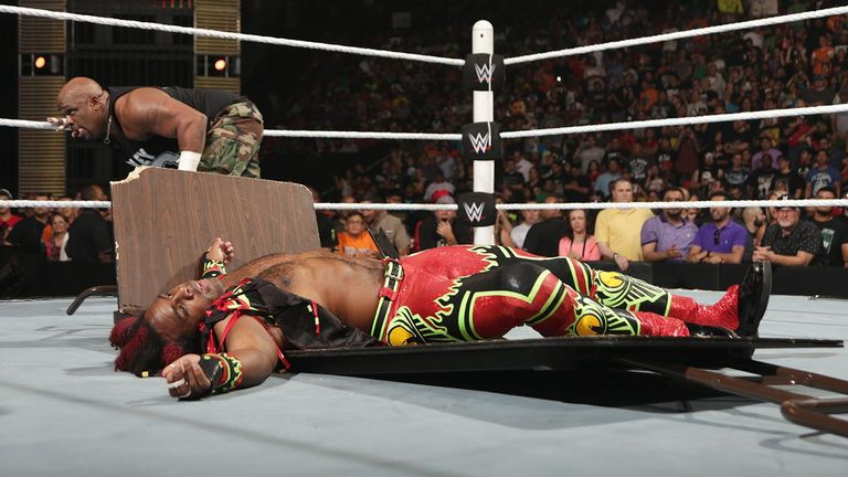 Image result for WWE wrestler going through a table