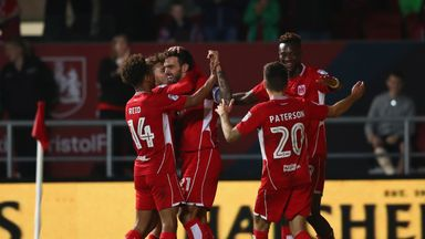 Marlon Pack (2L) of Bristol City celebrates after scoring against Leeds