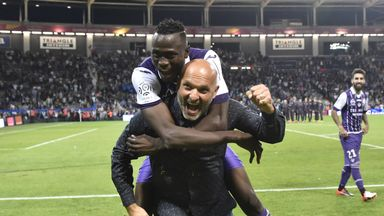 Issiaga Sylla celebrates with head coach Pascal Dupraz after beating PSG