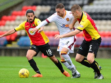Motherwell's Louis Moult (centre) holding off Partick Thistle defenders