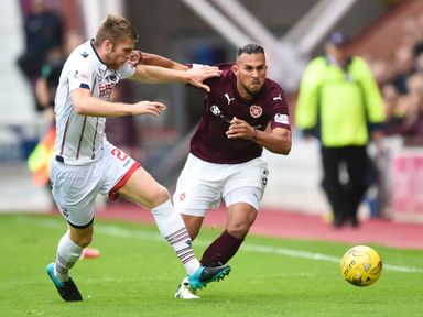 Ross County's Marcus Fraser (left) with Faycal Rherras