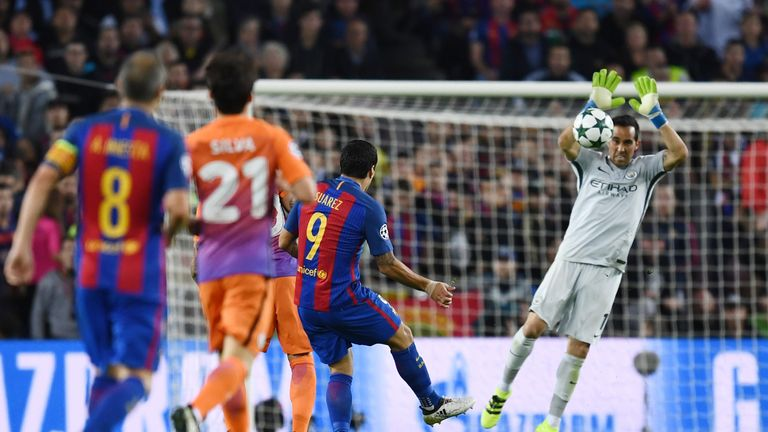 Claudio Bravo handles a shot from Luis Suarez outside of his area