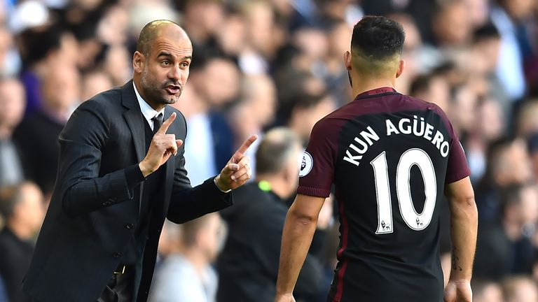 Pep Guardiola gives instructions to Sergio Aguero