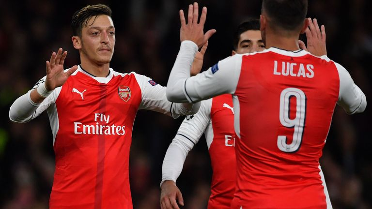 Ozil (L) celebrates with Hector Bellerin and Lucas perez
