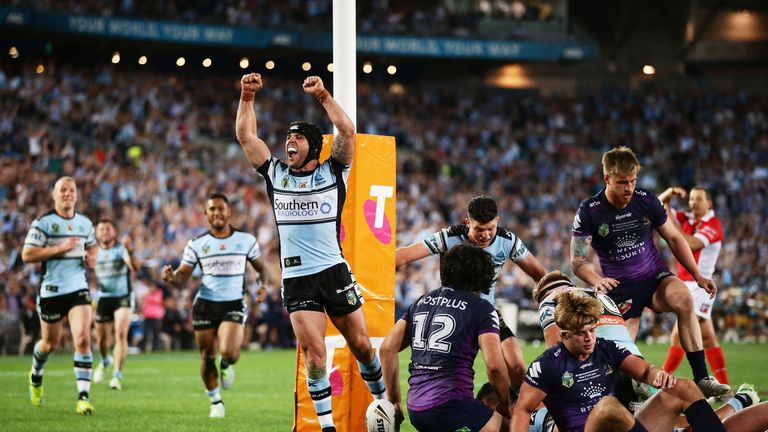 Michael Ennis  celebrates Andrew Fifita's try in the NRL Grand Final