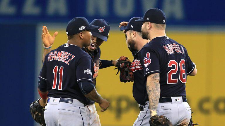 Jose Ramirez #11, Francisco Lindor,  Jason Kipnis and Mike Napoli #26 celebrate as Cleveland Indians reach World Series