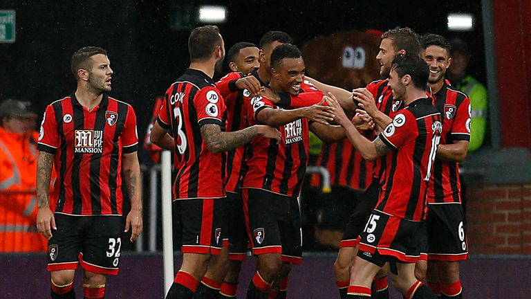 Bournemouth's Junior Stanislas (centre) celebrates after scoring his side's fourth goal against Hull City on Saturday
