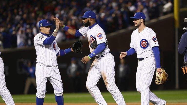 Javier Baez, Jason Heyward and Kris Bryant celebrate after the Cubs' 3-2 win