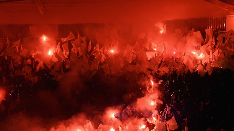 Copenhagen supporters set off flares inside the King Power Stadium prior to their match against Leicester