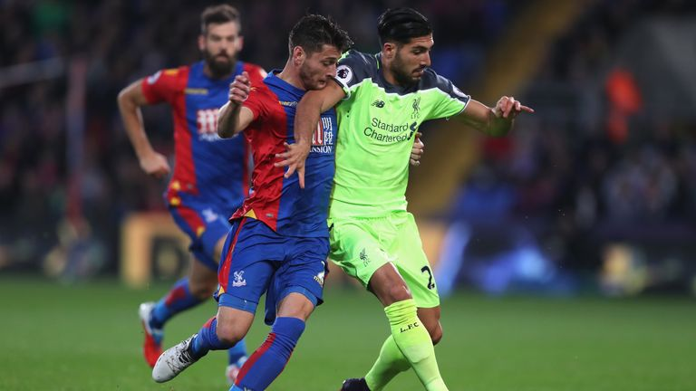 Emre Can holds off Joel Ward at Selhurst Park