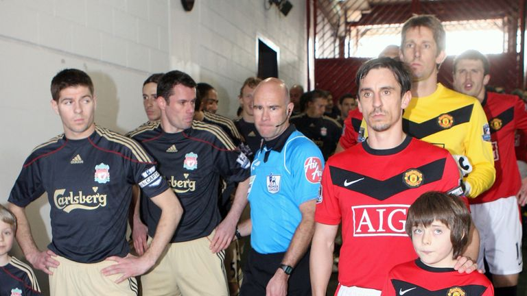 Steven Gerrard and Gary Neville leading out their teams for the derby clash