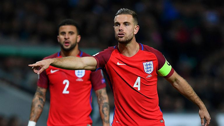 Jordan Henderson signals to his England team-mates during the Group F match