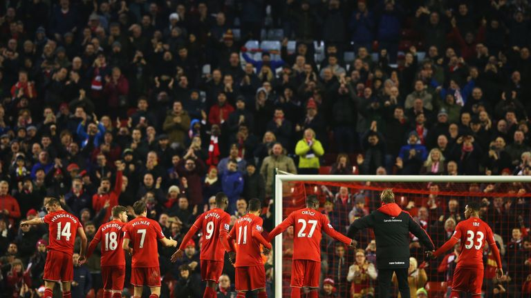 Jurgen Klopp and his Liverpool players salute The Kop after a 2-2 draw with West Brom last season