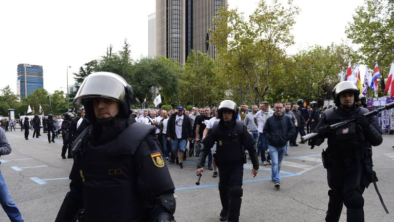 Legia Warsaw fans are escorted by Spanish poilce to Bernabeu Stadium