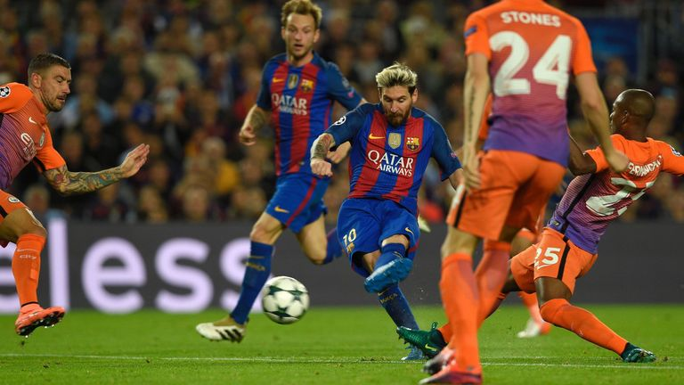 Messi (C) scores his second goal against Man City