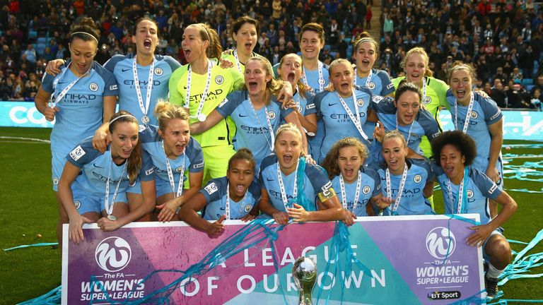 The Manchester City team celebrate after winning the Women's Super League