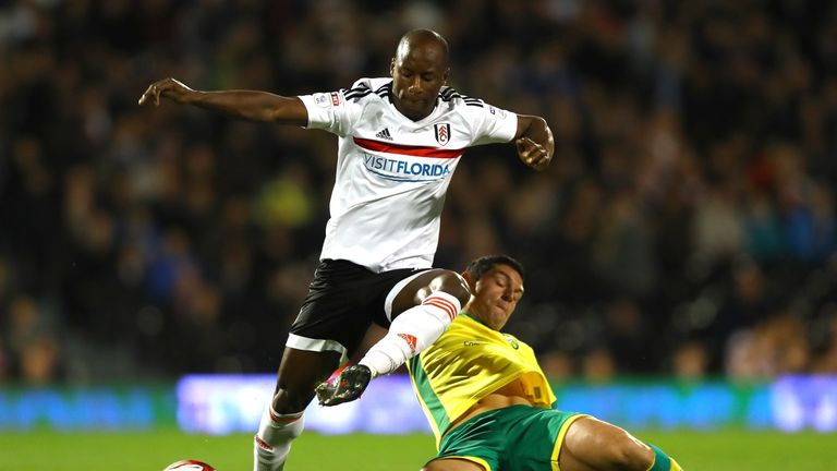 Fulham's Sone Aluko is challenged by Graham Dorrans of Norwich