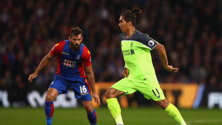 Roberto Firmino takes the ball past Joe Ledley