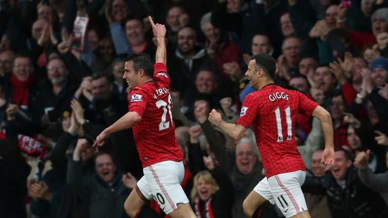 Van Persie celebrates with Ryan Giggs - who set up his two other goals on the night