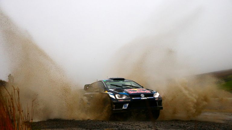 Sebastien Ogier splashed his way to another victory in Wales