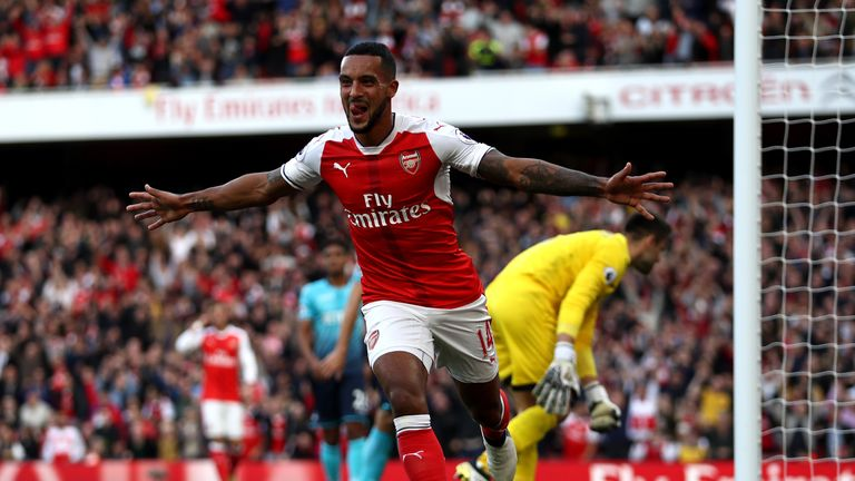 Theo Walcott celebrates scoring his side's first goal against Swansea