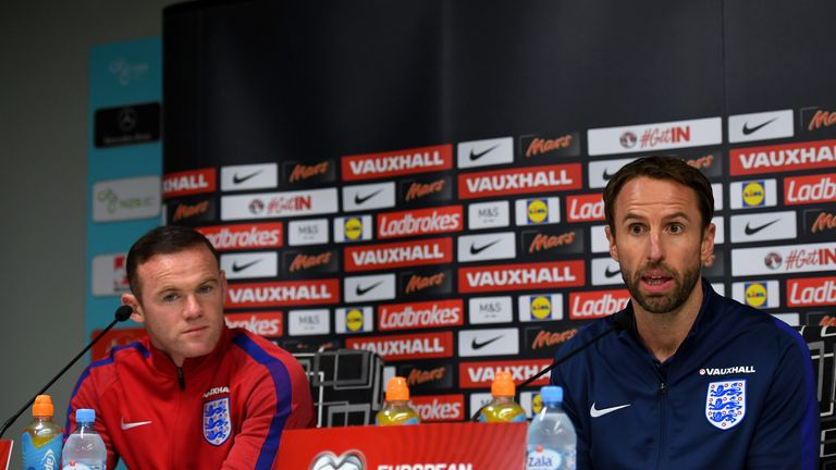 Gareth Southgate speaks next to Wayne Rooney during an England press conference