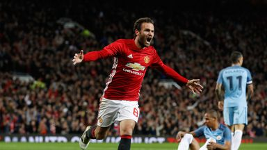 Manchester United's Juan Mata celebrates after scoring his side's first goal