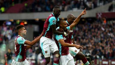 Winston Reid (R) of West Ham United celebrates scoring