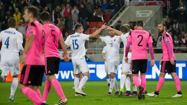 Scotland's Steven Fletcher (R) and Callum Paterson (2nd R) react after Slovakia's third goal