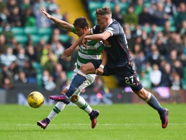 Cristian Gamboa and Ross MacLean compete for the ball