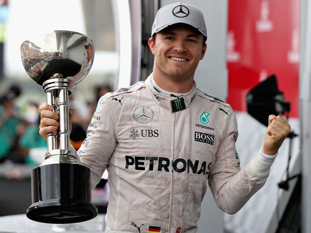 Nico Rosberg with the trophy after his win at Suzuka