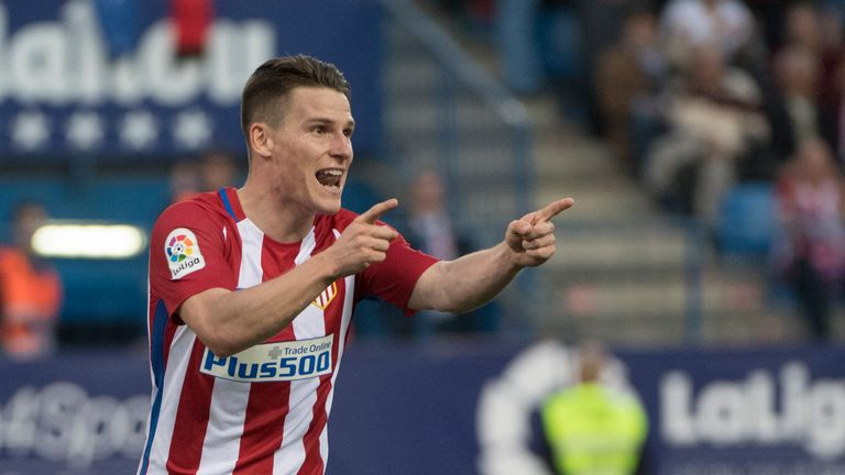 Atletico Madrid's French forward Kevin Gameiro celebrates after scoring during the Spanish league football match between Club Atletico de Madrid and Malaga
