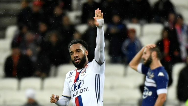 Alexandre Lacazette celebrates after scoring for Lyon