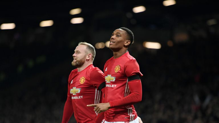 Martial celebrates with Wayne Rooney during United's win at Old Trafford