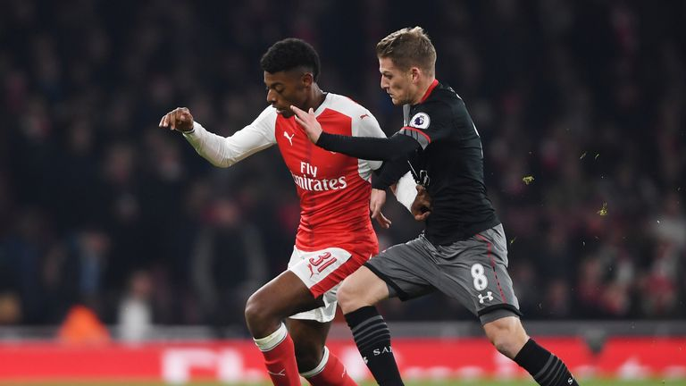 Jeff Reine-Adelaide of Arsenal holds off Southampton's Steven Davis