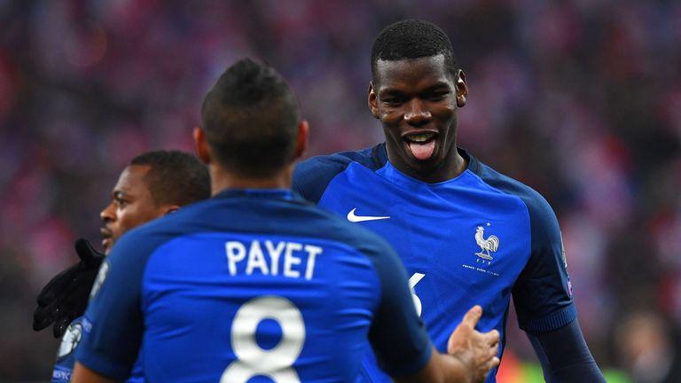 Paul Pogba celebrates with fellow-goalscorer Dimitri Payet