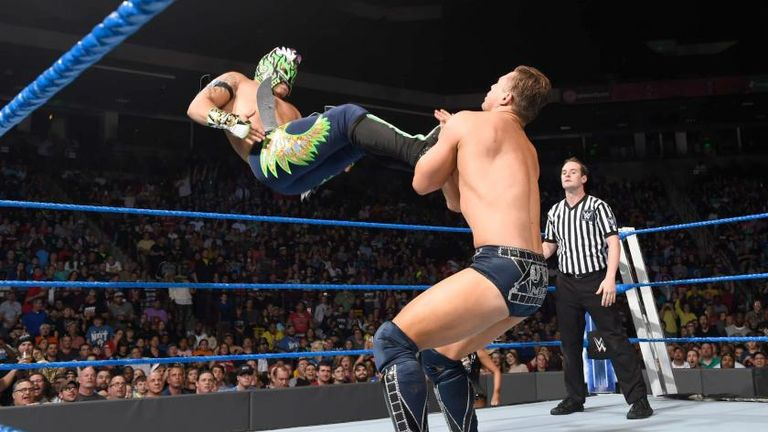 Kalisto dropkicks The Miz to the mat