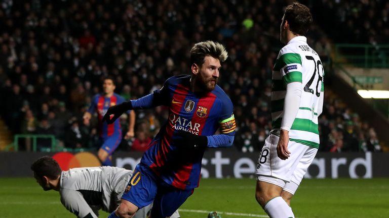 Lionel Messi of Barcelona celebrates scoring his side's first goal against Celtic