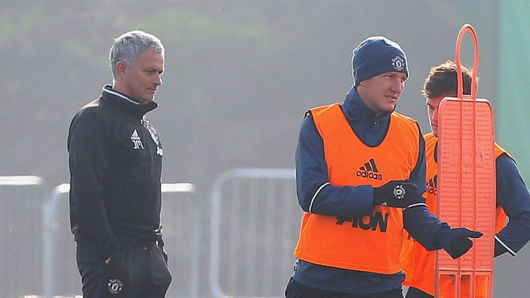 Manchester United manager Jose Mourinho puts Schweinsteiger through his paces in training
