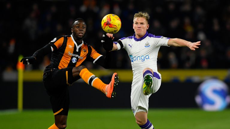 Adama Diomande of Hull City and Matt Ritchie of Newcastle United battle for the ball during the EFL Cup quarter-final